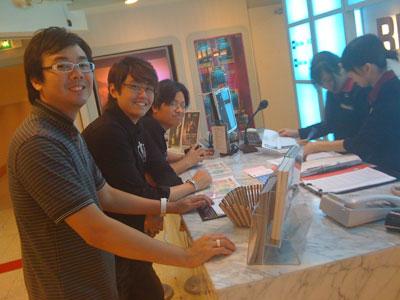 Jaz Lai, Edmund Toh and Khai Siung signing up at Red Box